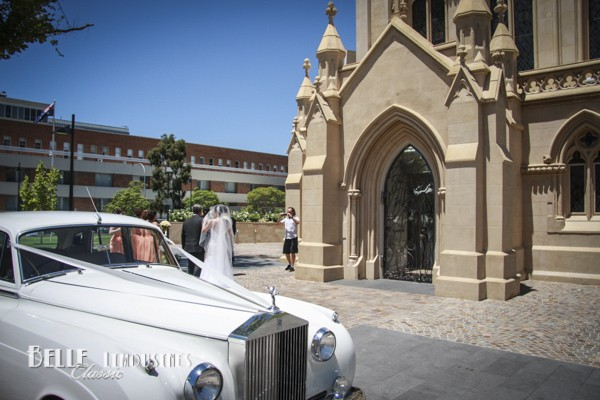 Our Rolls Royce bridal car delivering a bride to the entrance of St Mary's Cathedral