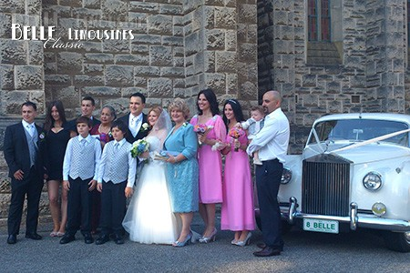 Formal wedding photography outside the chapel
